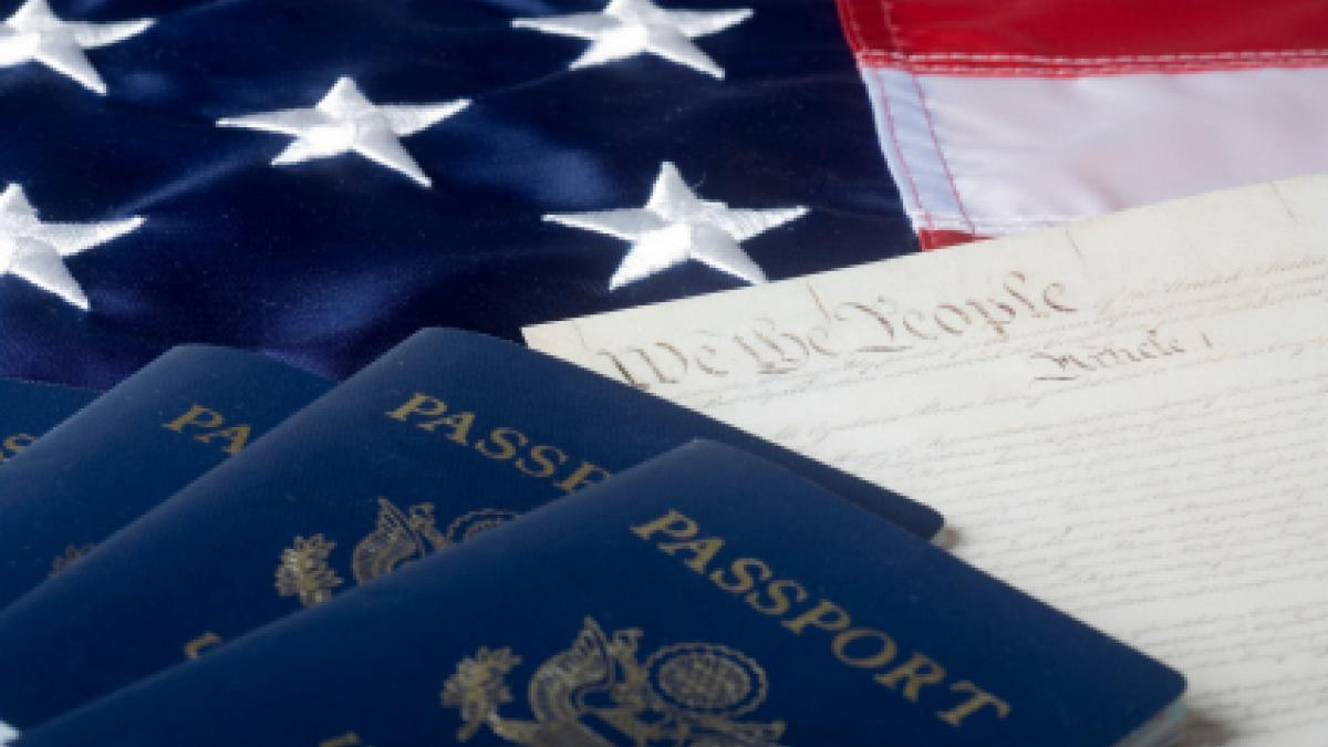 U.S. flag, U.S. passport and the American Constitution